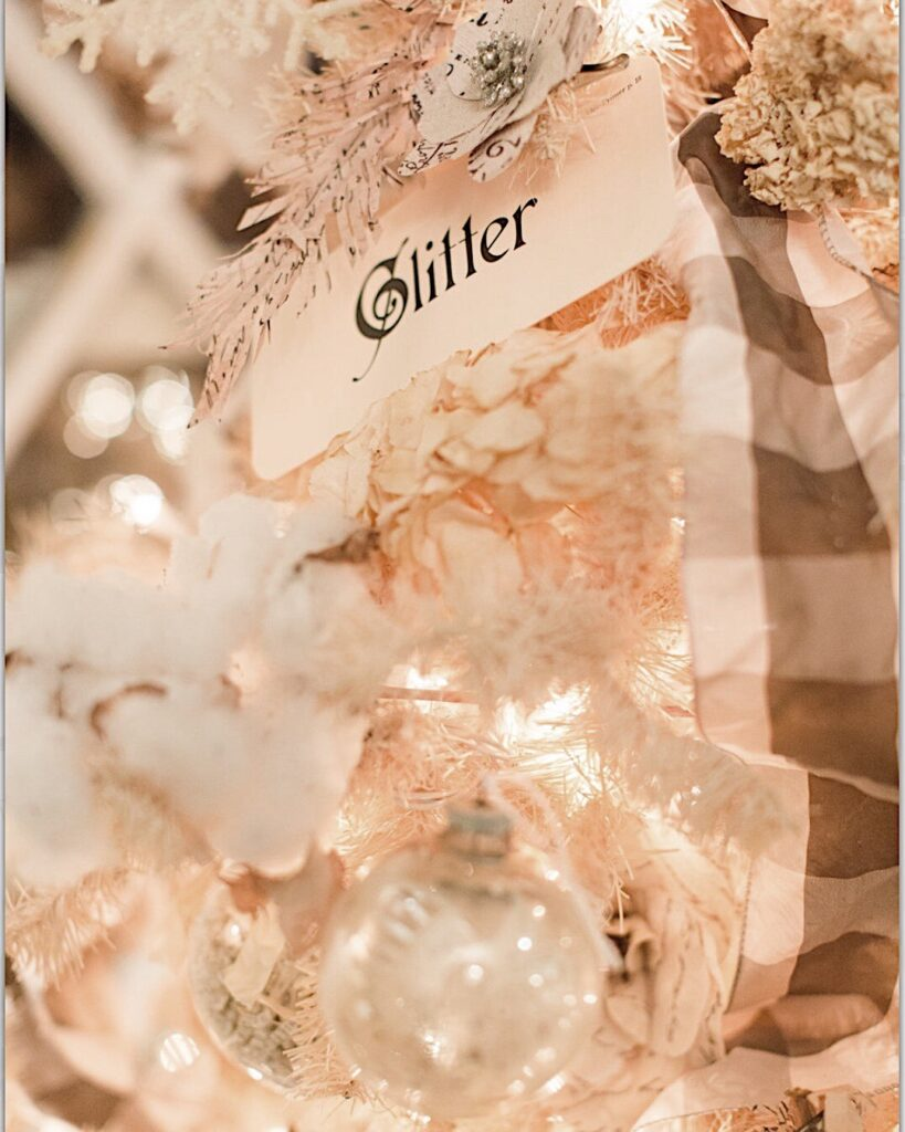 flash cards with Christmas words are used for christmas ornament on the white vintage Christmas tree.