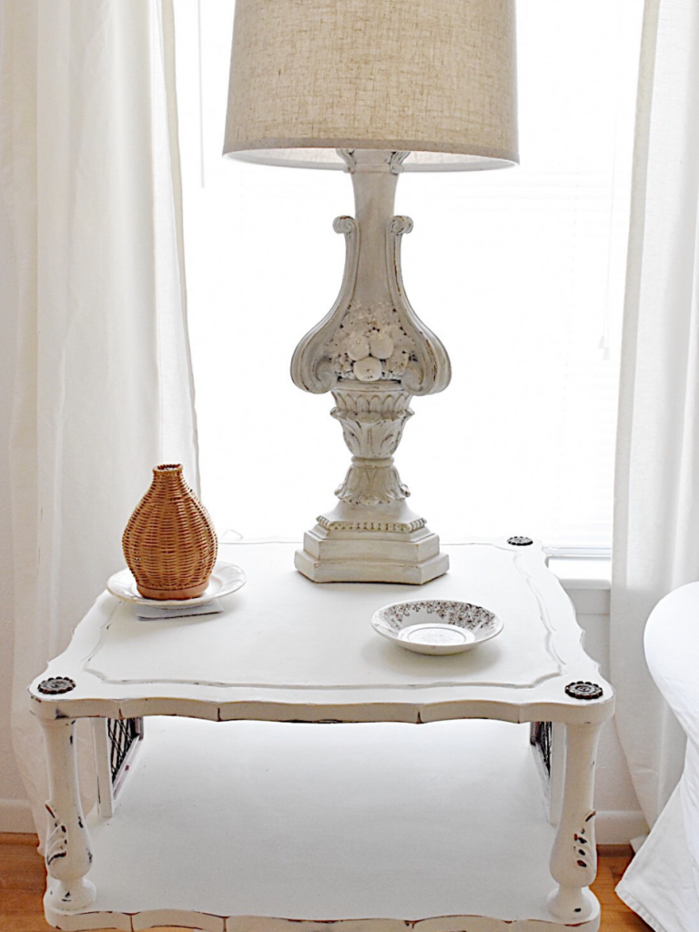 white square side table with lamp coaster diffuser beside couch