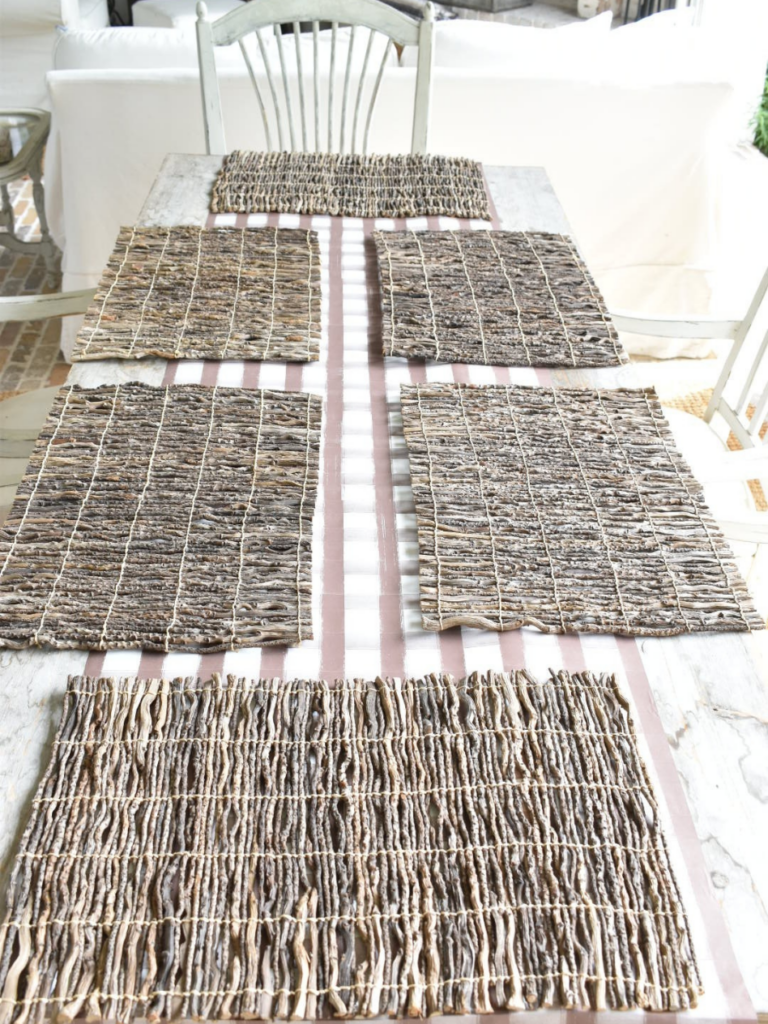 brown and white plaid paper table runner on outdoor rustic long dining table and 6 twig placesmats