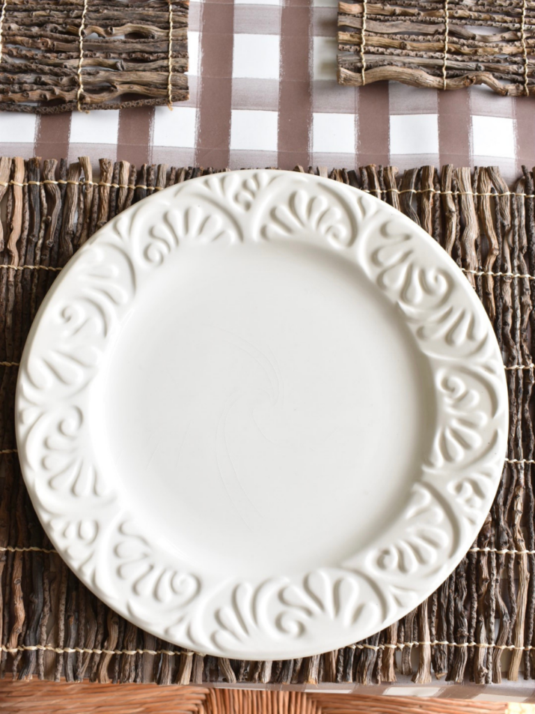 twig placemat with a large white dinner plate