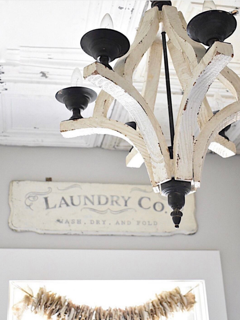 white light fixture with laundry room sign in background